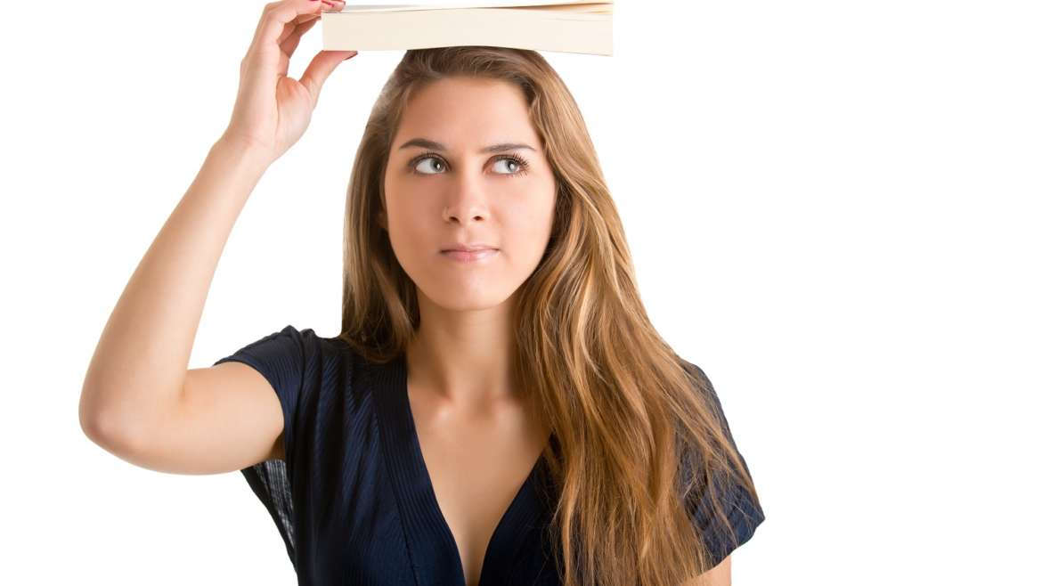 Do we need to put books on our head to stand correctly?